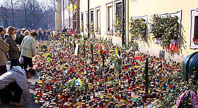 Mourners keeping vigil in front of the palace of Krakow's bishops